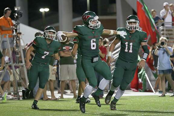 Defensive back Connor Binney (6) of The Woodlands Highlanders celebrates returning an interception for a touchdown against of the Dekaney Wildcats in the second half on Thursday, September 2, 2015 at Woodforest Bank Stadium in The Woodlands, TX. (For the Chronicle / Thomas B. Shea)