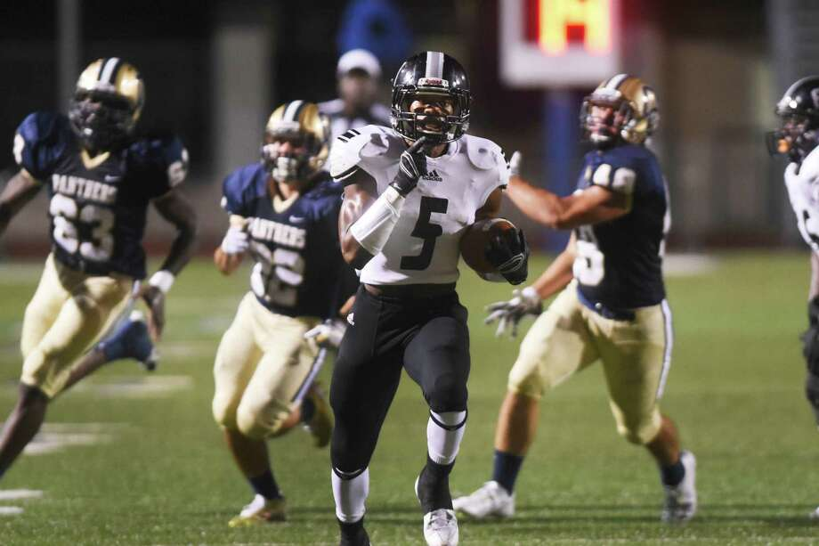 Steele running back Bryson Denley runs from a trio of O'Connor defenders during high school football action at Farris Stadium on Thursday, Sept. 10, 2015. Photo: Billy Calzada /San Antonio Express-News / San Antonio Express-News