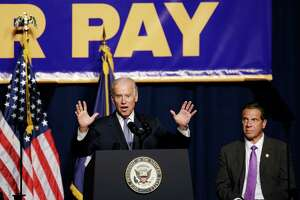 Vice President Joe Biden, accompanied by New York Gov. Andrew Cuomo, speaks during a labor rally, Thursday, Sept. 10, 2015 in New York. Cuomo is proposing to raise the state minimum wage to $15 an hour. (AP Photo/Mark Lennihan) ORG XMIT: NYML103