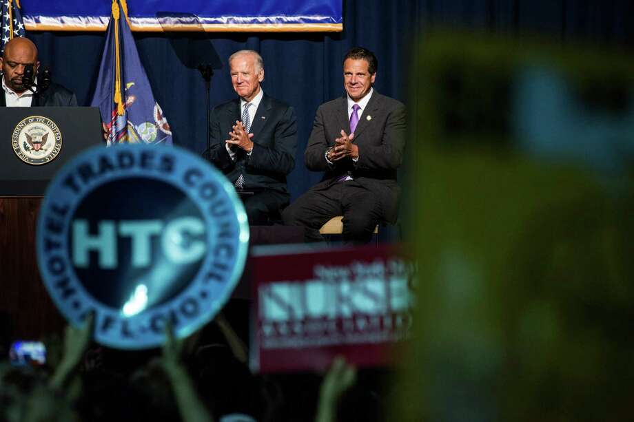 NEW YORK, NY - SEPTEMBER 10:  U.S. Vice President Joe Biden and New York Governor Andrew Cuomo attend a political rally announcing their support to raise the minimum wage for the state of New York to $15 per hour on September 10, 2015 in New York City. U.S. Vice President Joe Biden also said he would like to see the federal minimum wage risen to $12 per hour.  (Photo by Andrew Burton/Getty Images) ORG XMIT: 577146509 Photo: Andrew Burton / 2015 Getty Images