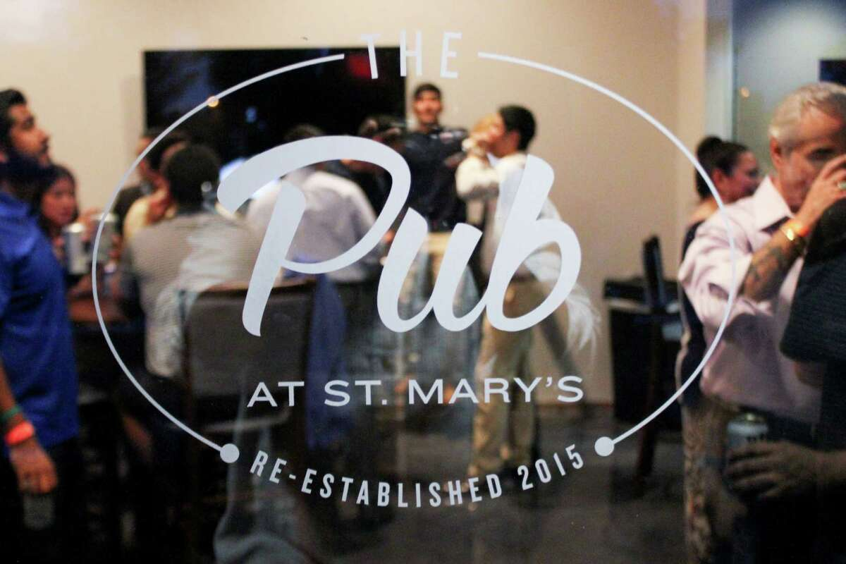 Dozens of people came out for the grand opening Thursday of St. Mary's University's Pub, an on-campus watering hole that has returned to the school for 25 years.