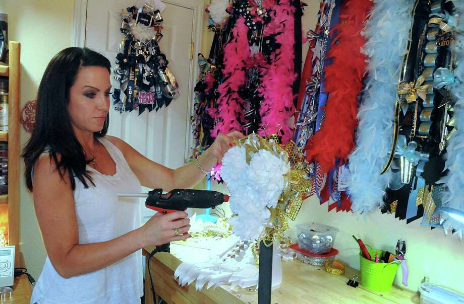 Michelle Turcato works on a homecoming mum in her studio. She has a full time job, but makes the mums at night and on the weekends. Photo: David Hopper, Freelance / freelance