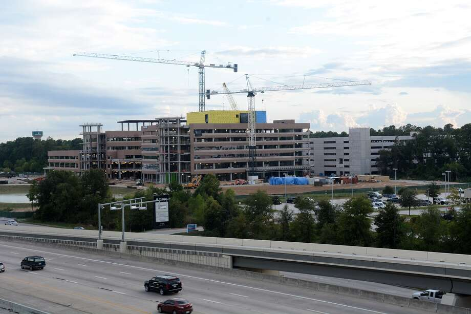 Business growth along the Texas 242 intersection with Interstate 45 has given a boost to The Woodlands economy. Texas Children's Hospital's $360 million, 548,000-square-foot pediatric facility is under construction on the southwest side of I-45 and Texas 242. Photo: Jerry Baker, Freelance
