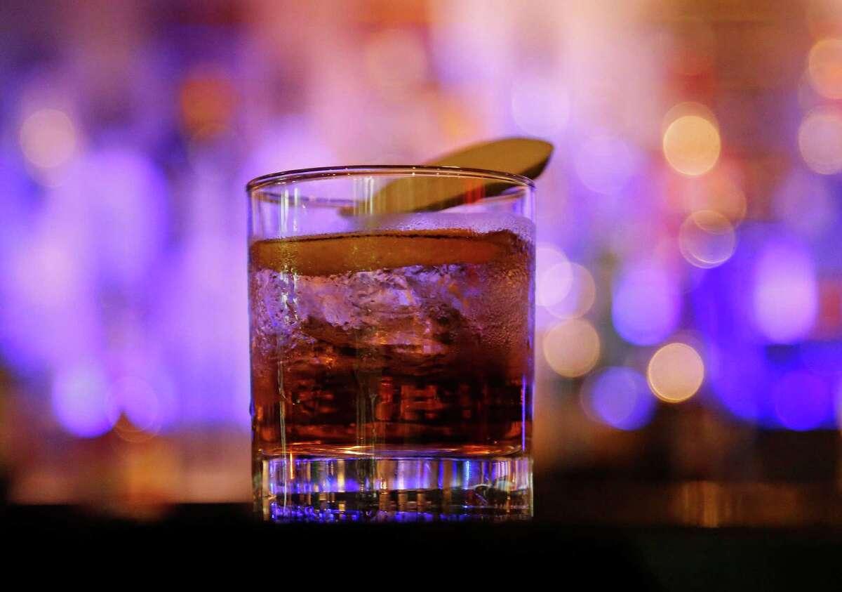 The Shiso Apple Whisky cocktail: Bulleit Rye, vanilla syrup, apple bitters, lemon peel and shiso leaf at Tarakaan restaurant Thursday, Sept. 10, 2015, in Houston.