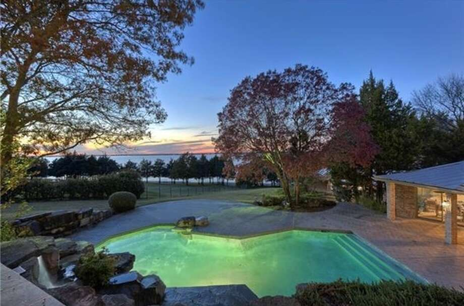 Former Miss Texas June Williams and her husband, Bob, a real estate developer, listed this waterfront home for $2.4 million.  The home is located along Lake Ray Hubbard's east coast, and includes three bedrooms, 3.5 bathrooms, a chef's kitchen and a pool.Source: Trulia Photo: Courtesy, Trulia