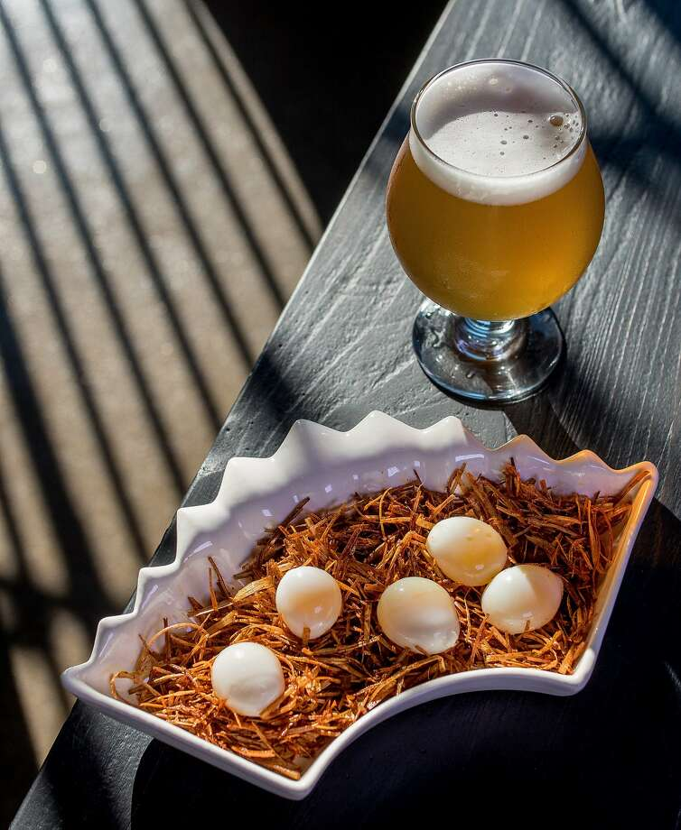 Chef Max Snyder's pickled quail eggs ($8), above, and a beer at Old Bus Tavern in S.F. Left: The house chili ($16), with no beans, is an intense braised beef stew. Photo: John Storey
