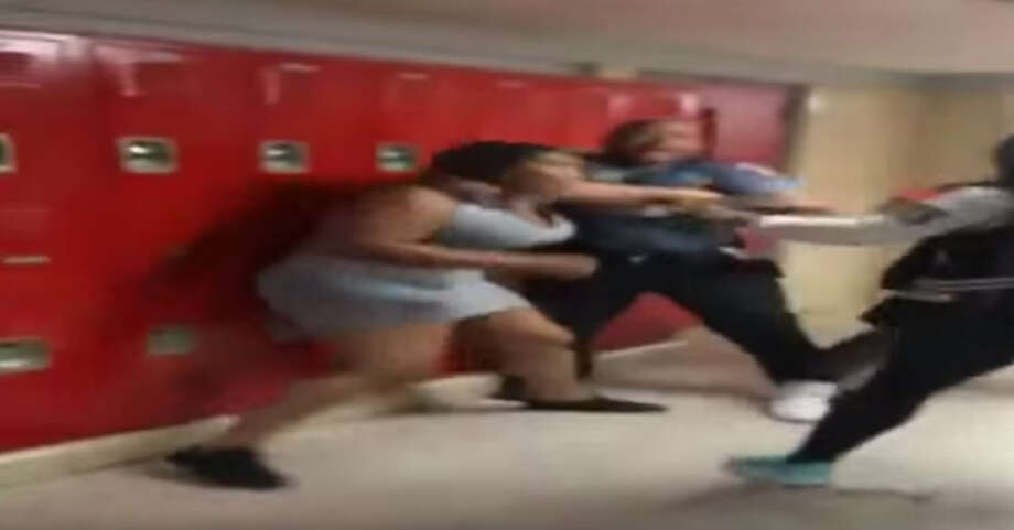 A campus security guard was injured attempting to break up a fight between students at Bellaire High School in September 2015. Photo: YouTube