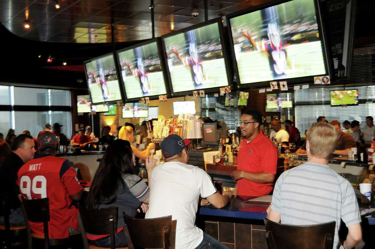 Fans watch the game against the Cowboys at the Houston Texans Grille in City Centre Thursday Sept. 3,2015.(Dave Rossman photo)