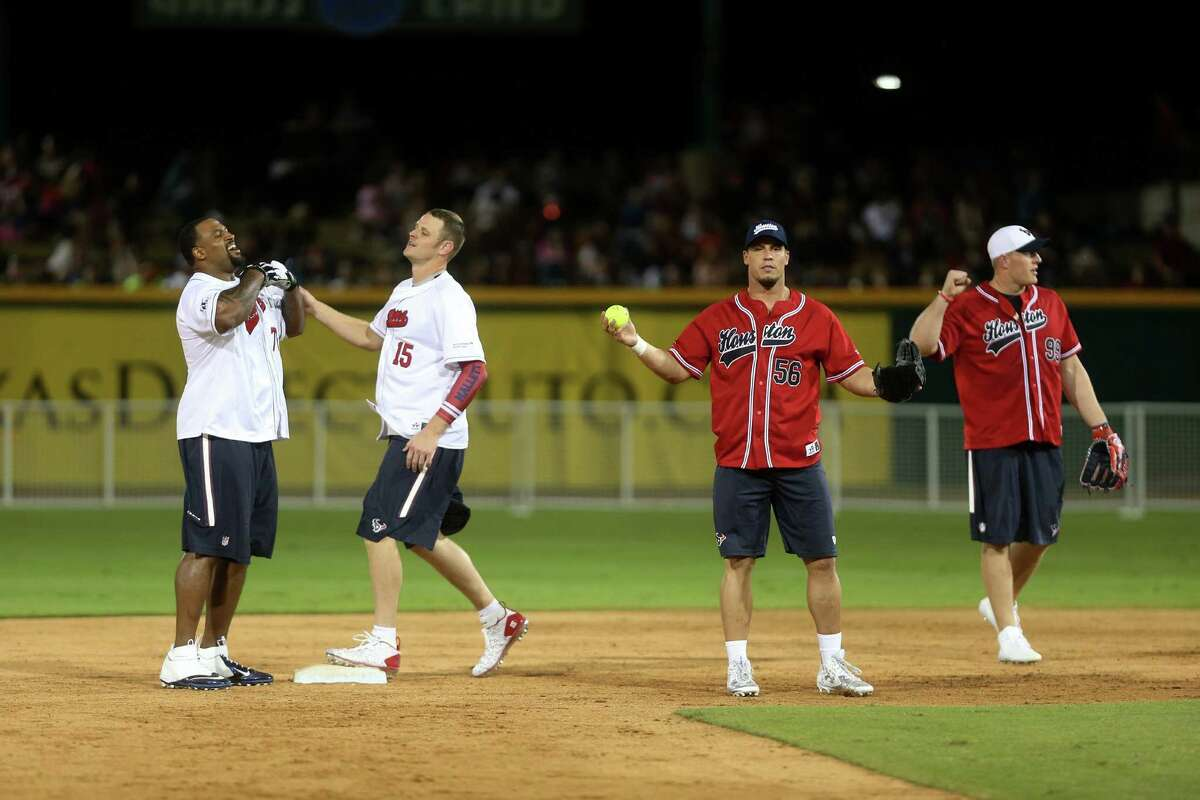 Derek Newton and Ryan Mallett are tagged out of second base by Brian Cushing and J.J. Watt during the J.J. Watt Charity Classic at Constellation Field on Friday, May 1, 2015, in Sugar Land. ( Mayra Beltran / Houston Chronicle )
