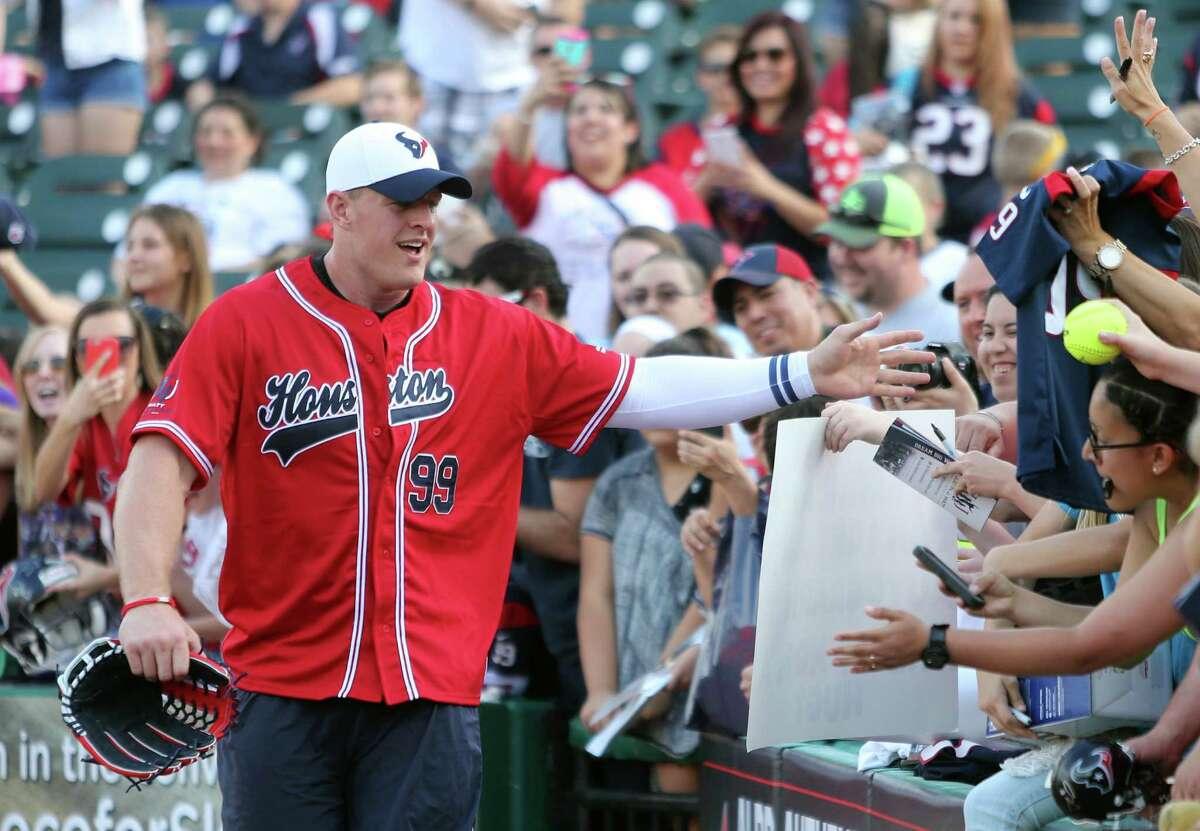 J.J. Watt greets his fans at the start of the J.J. Watt Charity Classic at Constellation Field on Friday, May 1, 2015, in Sugar Land. ( Mayra Beltran / Houston Chronicle )
