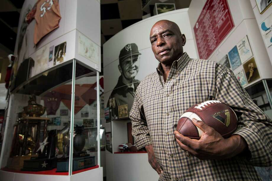 Former University of Houston running back Warren McVea poses for a portrait in the UH Hall of Fame on Wednesday, Sept. 9, 2015, in Houston. Offered scholarships by 73 colleges in 1964, McVea signed with the University of Houston, making history by becoming the first African-American to play football for the Cougars. ( Photo: Brett Coomer /Houston Chronicle / © 2015 Houston Chronicle