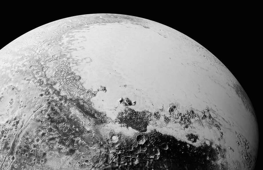 This synthetic perspective view of Pluto, based on the latest high-resolution images to be downlinked from NASA's New Horizons spacecraft, shows what you would see if you were approximately 1,100 miles (1,800 kilometers) above Pluto's equatorial area, looking northeast over the dark, cratered, informally named Cthulhu Regio toward the bright, smooth, expanse of icy plains informally called Sputnik Planum. The entire expanse of terrain seen in this image is 1,100 miles (1,800 kilometers) across. The images were taken as New Horizons flew past Pluto on July 14, 2015, from a distance of 50,000 miles (80,000 kilometers). Photo: NASA/Johns Hopkins University Applied Physics Laboratory/Southwest Research Institute