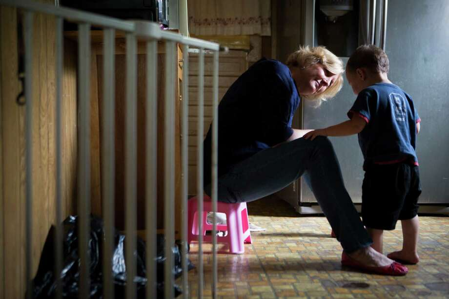 Child Protective Service investigator Heather Pohl becomes familiar with a 2-year-old boy who was found walking by himself along a busy street. Photo: Marie D. De Jesus, Houston Chronicle / Â 2015 Houston Chronicle