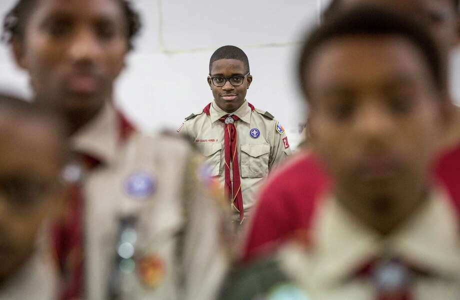 Benjamin White, a Boy Scout with Troop 242, smiles during a rehearsal for a ceremony honoring their troop, at Wheeler Avenue Baptist Church Thursday, Sept. 10, 2015, in Houston. Troop 242 is a historically African-American Boy Scout troop which has produced 174 Eagle Scouts. Photo: Jon Shapley, Houston Chronicle / © 2015 Houston Chronicle