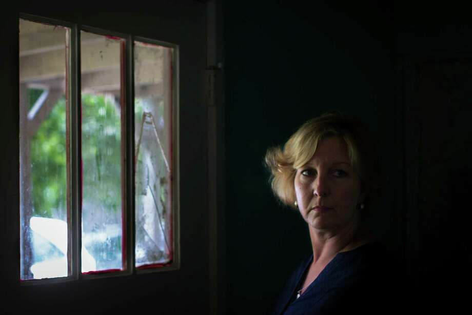 Pohl has been a Texas CPS caseworker for 18 years. She joined on a whim, after she tore a tab from a flyer advertising an agency internship on the West Coast. Photo: Marie D. De Jesus, Houston Chronicle / © 2015 Houston Chronicle