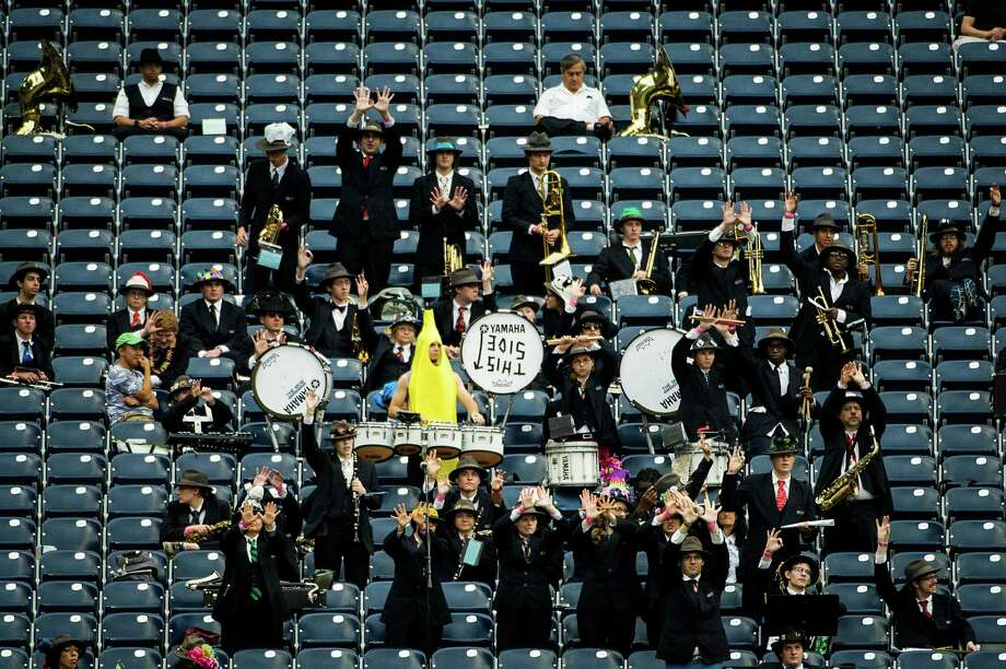 The Rice University Marching Owl Band (MOB) cheers for their team against Houston during the first half of the annual Bayou Bucket college football game at Reliant Stadium, Saturday, Sept. 21, 2013, in Houston. Photo: Houston Chronicle File Photo / © 2013  Houston Chronicle