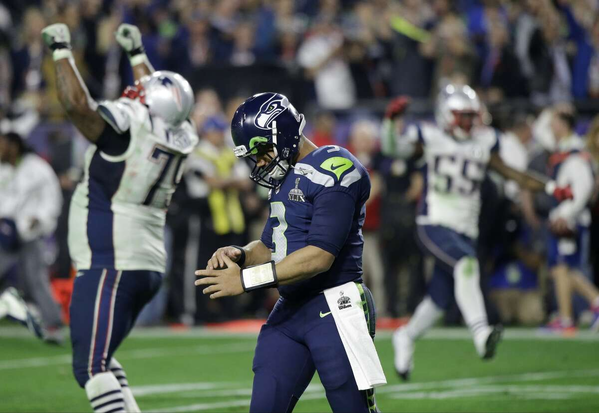 Seattle Seahawks quarterback Russell Wilson walks off the field after throwing the game-clinching interception to New England Patriots cornerback Malcolm Butler in Super Bowl XLIX on Sunday, Feb. 1, 2015, in Glendale, Ariz.