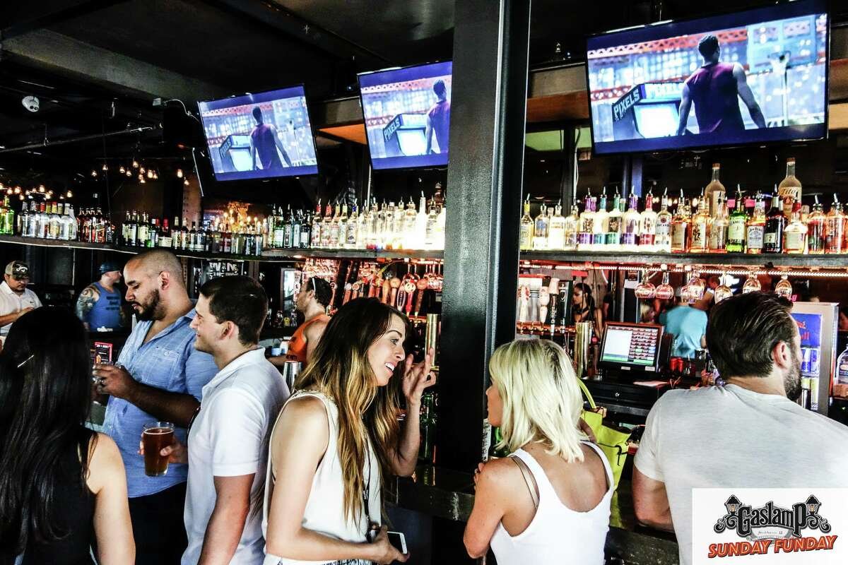 Three black attorneys allege that they were asked to pay a cover charge to enter the Gaslamp, a bar in Midtown, though they saw white patrons enter without paying the charge.