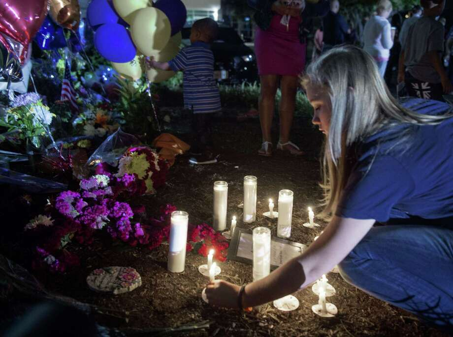People in Roanoke participate in a candlelight vigil placing their candles near the memorial shrine of balloons and flowers on the front driveway of WDBJ-TV's television studios on August 27. The brazen killing of two journalists during a live television broadcast by a former reporter fired by the station put focus anew on mental health and violence, though the mentally ill mostly cannot be blamed for mass shootings. Photo: PAUL J. RICHARDS /AFP / Getty Images / AFP
