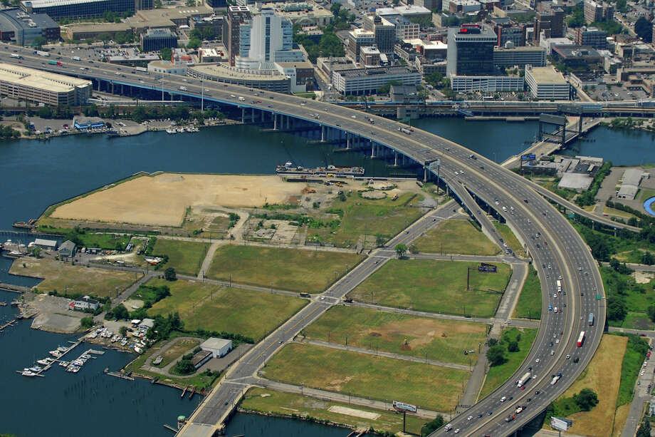 The Steel Point peninsula in Bridgeport in 2013. Before construction began in recent years, passing motorists on I-95 saw nothing but a vast vacant lot along the waterfront. Photo: Morgan Kaolian AEROPIX / Morgan Kaolian AEROPIX / Morgan Kaolian AEROPIX