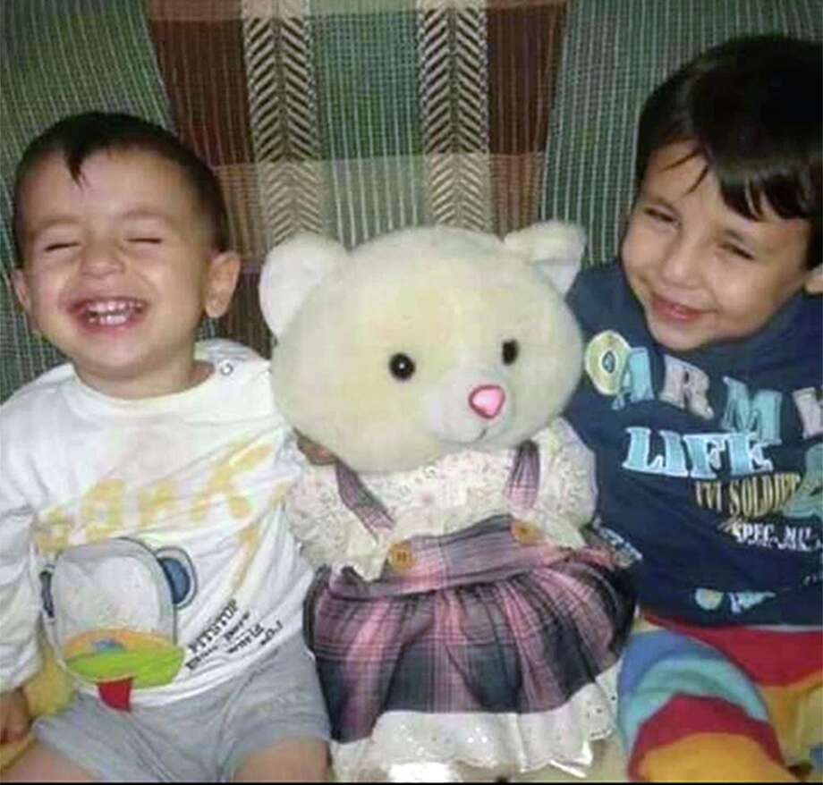 The body of 3-year-old Syrian Alan Kurdi (left) was found on a Turkish beach after the small rubber boat he, his 5-year old brother Galib (right) and their mother, Rehan, were in capsized during a desperate voyage from Turkey to Greece. The family stated that the spelling of the boys names had been changed by Turkish authorities to Aylan and Galip, but were in fact spelled as Alan and Galib. Photo: Courtesy Of Tima Kurdi / The Canadian Press / Associated Press / Photo courtesy of Tima Kurdi /Th