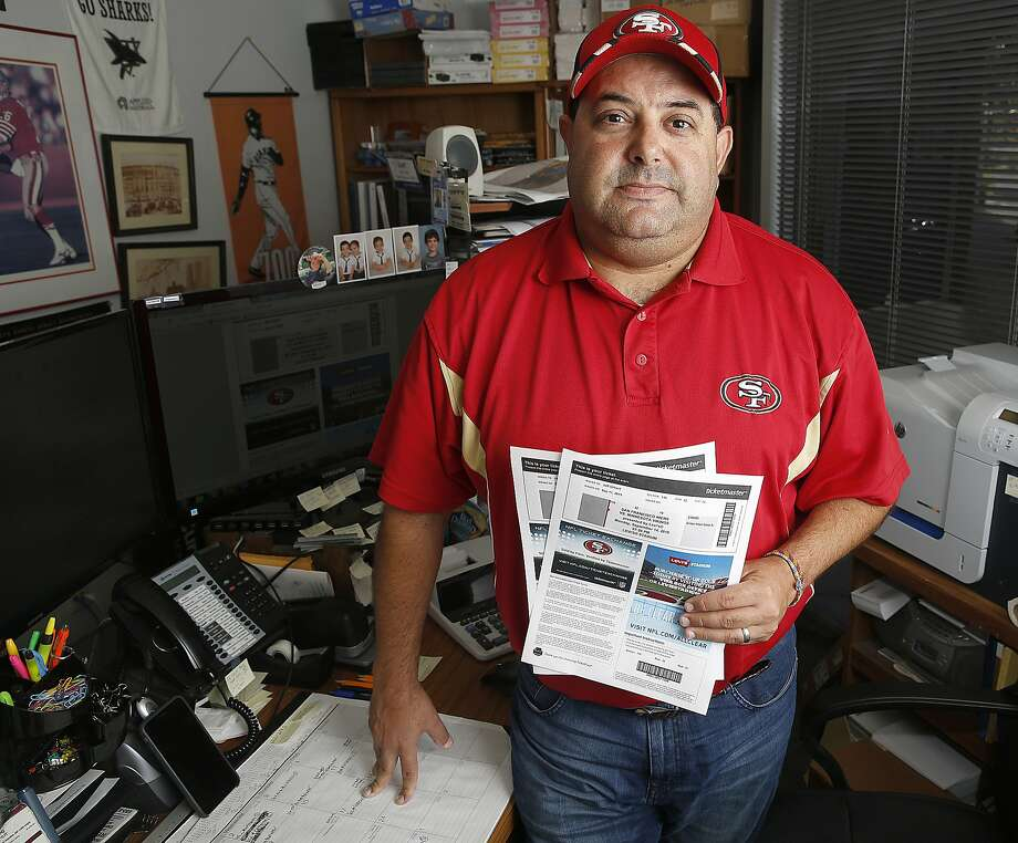 Longtime 49ers season ticket holder Jeff Gilbert talks about how tickets are now issued in San Mateo, Calif., on Friday, September 11, 2015.  He uses his tickets 99% percent of the time.  But in trying to sell his preseason tickets, it didn't sell.  The Niners restricted his seats to be sold at $70 through Ticketmaster which Gilbert would have priced at a lower price on StubHub which can no longer be used. Photo: Liz Hafalia, The Chronicle