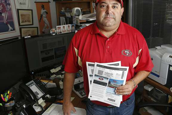 Longtime 49ers season ticket holder Jeff Gilbert talks about how tickets are now issued in San Mateo, Calif., on Friday, September 11, 2015.  He uses his tickets 99% percent of the time.  But in trying to sell his preseason tickets, it didn't sell.  The Niners restricted his seats to be sold at $70 through Ticketmaster which Gilbert would have priced at a lower price on StubHub which can no longer be used.