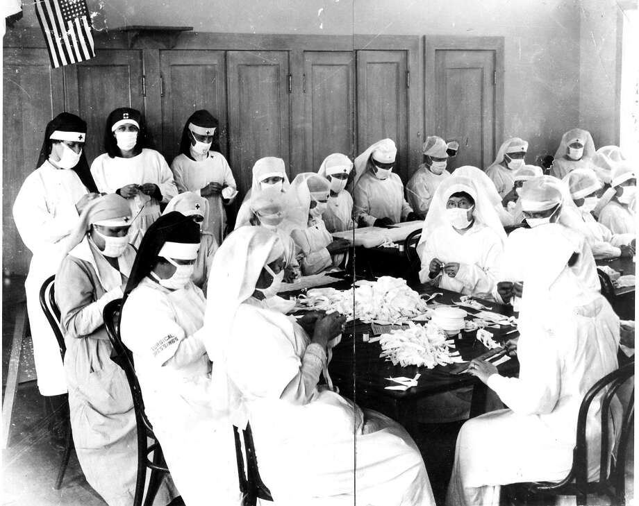 Women make masks to slow down the spread of the flu