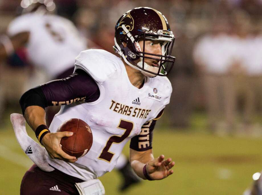 Texas State quarterback Tyler Jones runs during the first half against Florida State in Tallahassee, Fla., on Sept. 5, 2015. Photo: Mark Wallheiser /Associated Press / FR171224 AP