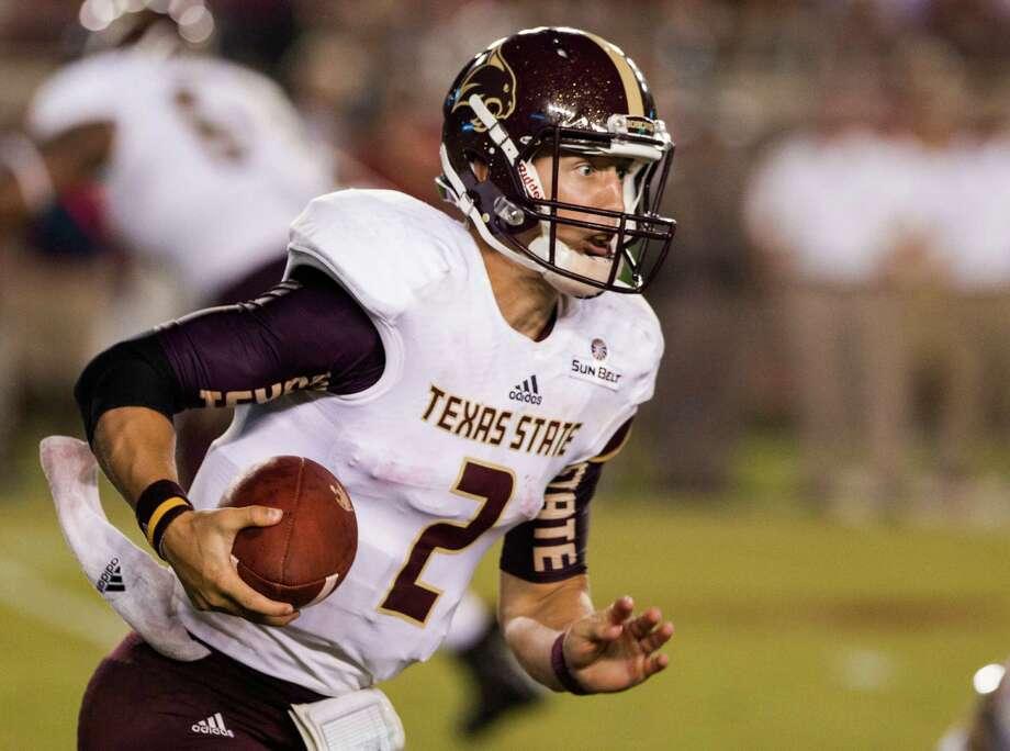 Texas State quarterback Tyler Jones runs during the first half against Florida State in Tallahassee, Fla., on Sept. 5, 2015. Photo: Mark Wallheiser /Associated Press / FR171224 AP