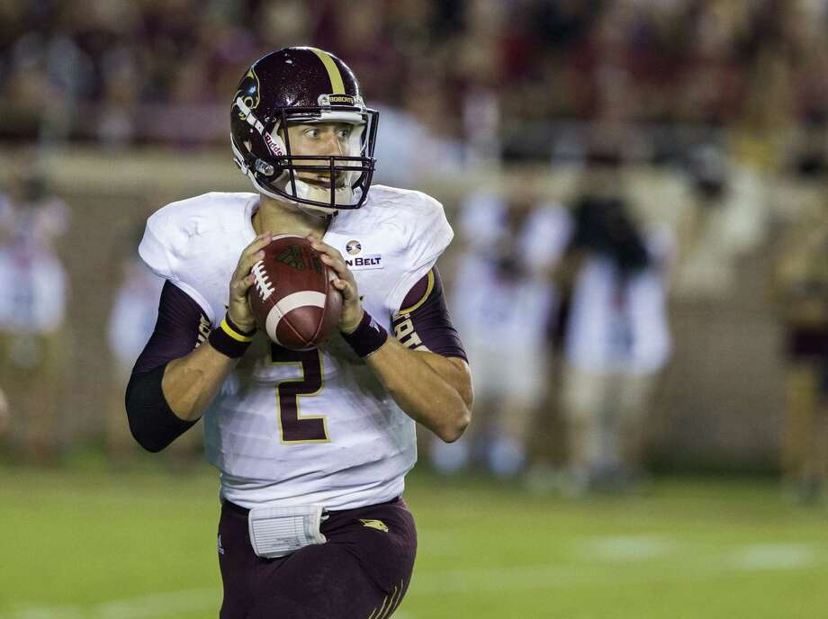 Texas State quarterback Tyler Jones rolls out to pass in the first half of an against Florida State in Tallahassee, Fla., on Sept. 5, 2015. Photo: Mark Wallheiser /Associated Press / FR171224 AP