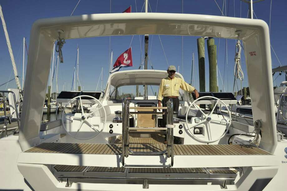 Michael Frank, president of Prestige Yacht and Sales, shows off a Beneteau Oceanis 55 sailboat at the 2013 Norwalk Boat Show in Norwalk, Conn. Photo: Jason Rearick / Jason Rearick / Stamford Advocate