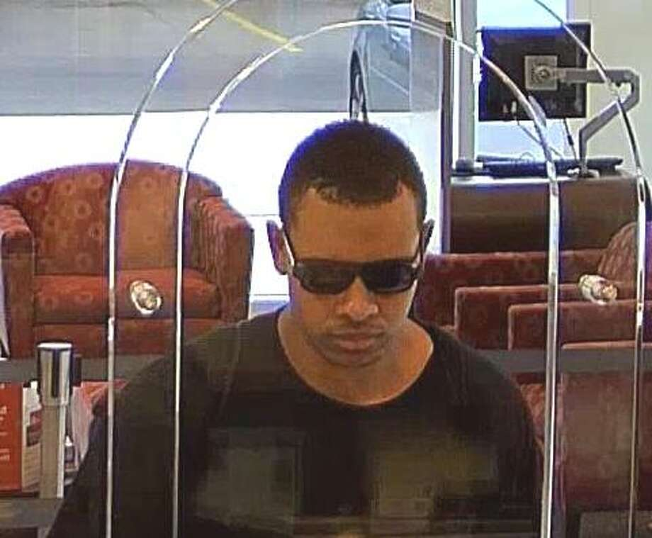 This man is suspected to have robbed a Wells Fargo bank at 5219 Richmond Avenue. He is still at large.