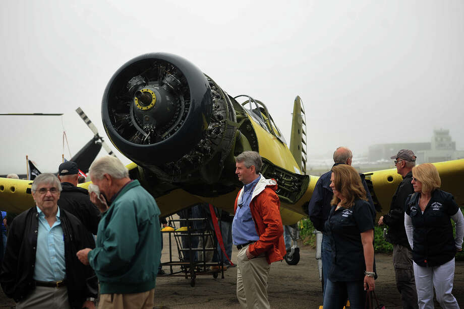 A World War 2 Corsair fighter plane being restored by the Connecticut Air & Space Center in Stratford is on display at the groundbreaking ceremony for the Curtiss Hangar restoration project at Sikorsky Airport in Stratford, Conn. on Tuesday, May 19, 2015. The craft will be on display at Sunday's car show. Photo: Brian A. Pounds / Brian A. Pounds / Connecticut Post