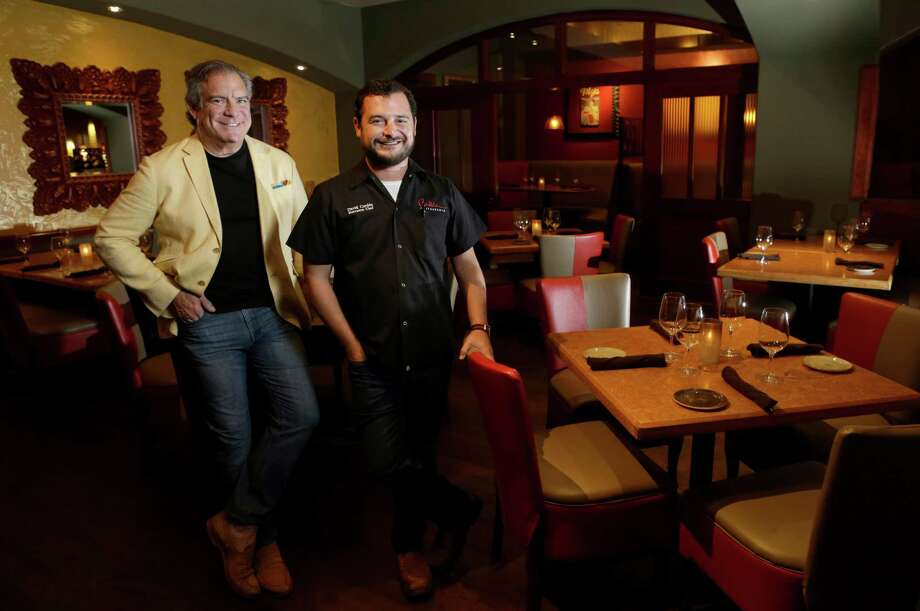 Michael Cordúa, founder and chairman of the board, left, and David Cordúa, right, executive chef, right, are shown in the just-completed renovation at Churrascos. Photo: Melissa Phillip, Staff / © 2015 Houston Chronicle