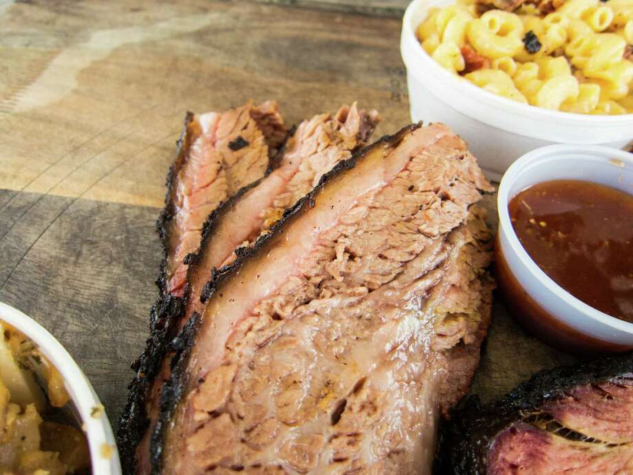 Brisket with side dishes at Brooks' Place BBQ in Cypress.