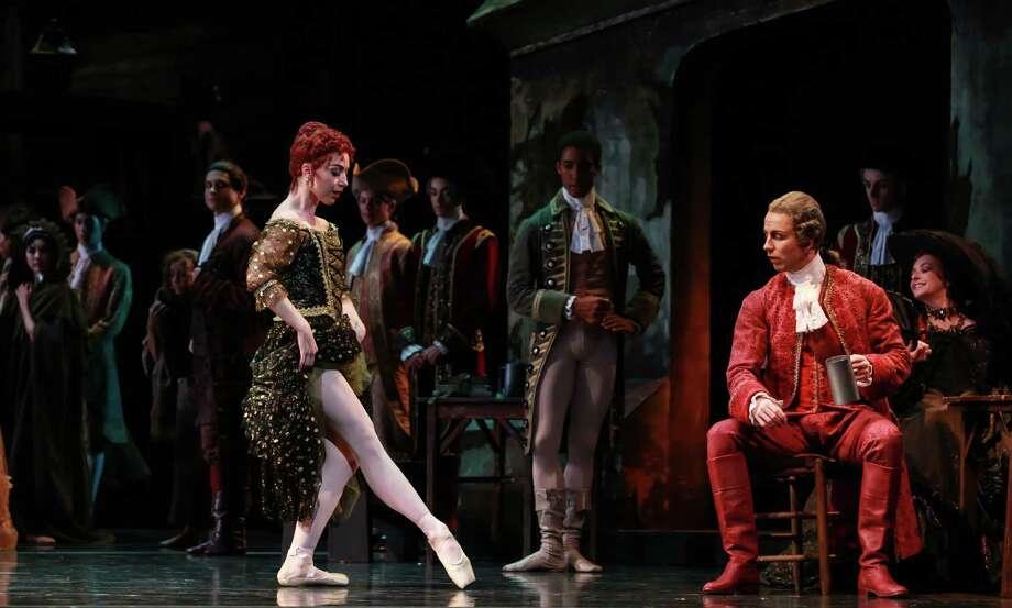 "Lescaut's Mistress (Jessica Collado), tempts Monsieur G.M. (Linnar Looris), in Houston Ballet's production of Sir Kenneth MacMillan's ""Manon."" Photo: Amitava Sarkar"