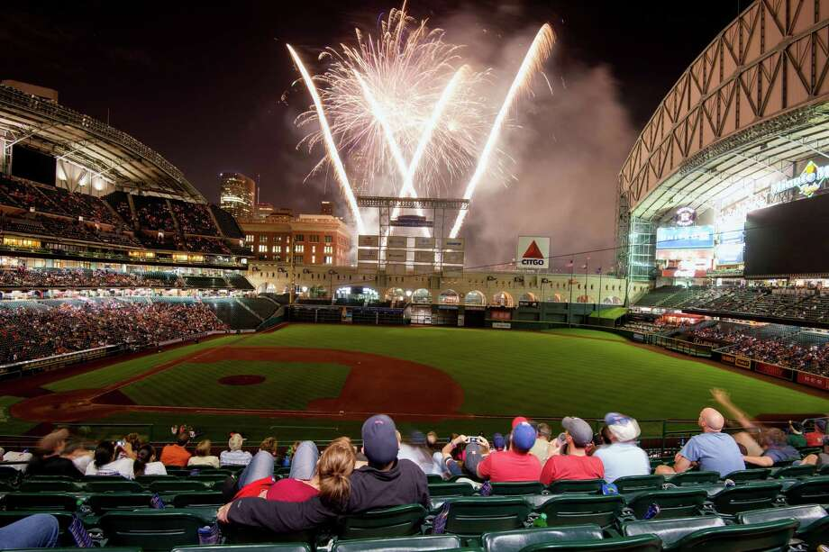 If attending an Astros game is on your bucket list, consider a Friday night game when Minute Maid Park offers a fireworks display. Photo: Smiley N. Pool / © 2013  Smiley N. Pool