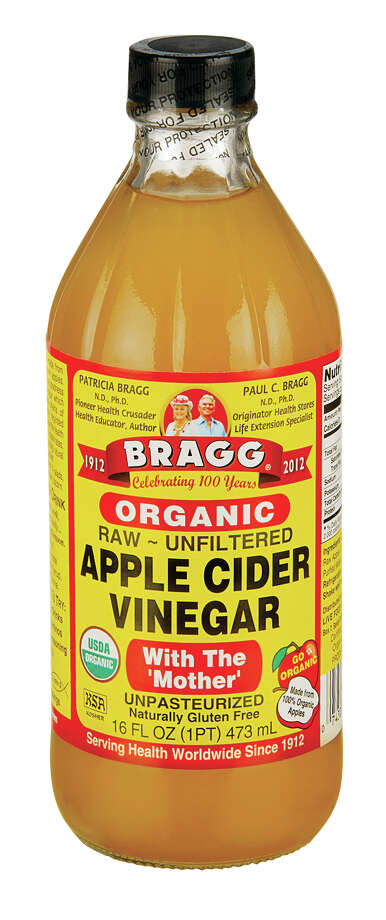 This photo courtesy of Bragg Live Food Products shows apple cider vinegar. Like many natural beauty, household and wellness fixes, apple cider vinegar has a long history and dedicated groupies who stand by its powers to help with everything from rust and flies to weight loss and warts. (Courtesy of Bragg Live Food Products via AP)  ORG XMIT: NYHO102 / Courtesy of Bragg Live Food Products