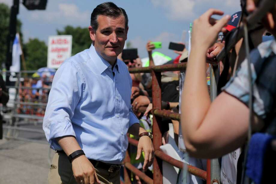 Sen. Ted Cruz, a Republican presidential hopeful, meets with demonstrators outside the Carter County Detention Center before the release from jail County Clerk Kim Davis. A reader criticizes Cruz for opportunistically opposing the letter of the law. Photo: ANDREW SPEAR /New York Times / NYTNS
