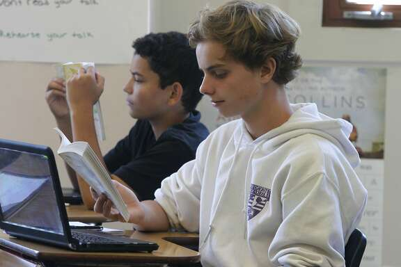 "Miles Fawcett (left) and Kevin Judd read ""Lord of the Flies in Debbi Hill's 9th grade English class at Piedmont High School in Piedmont, Calif. on Friday, Sept. 10, 2015. Piedmont High is one of the highest achieving schools in the Bay Area."