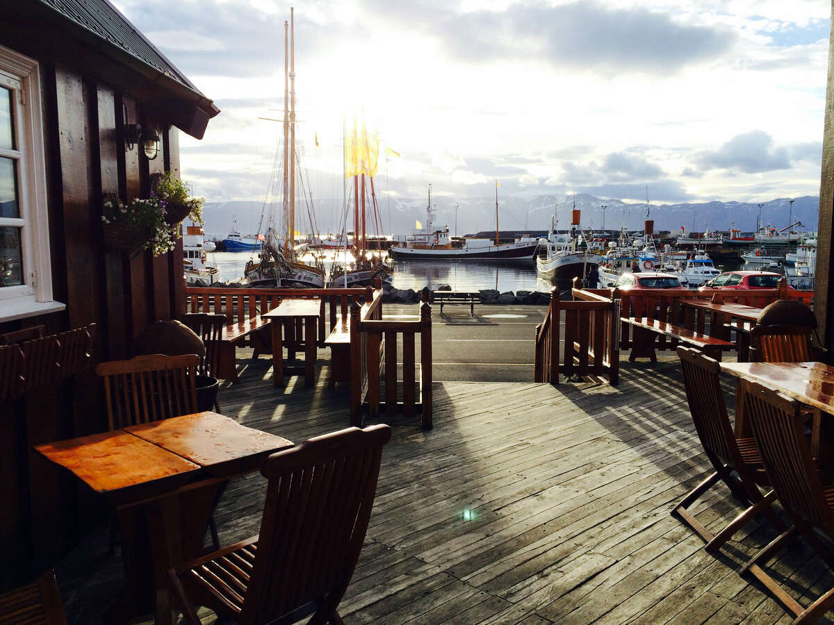 """The tiny harbor of Husavik, which means """"bay of houses,"""" a town of just 2,300 people."""