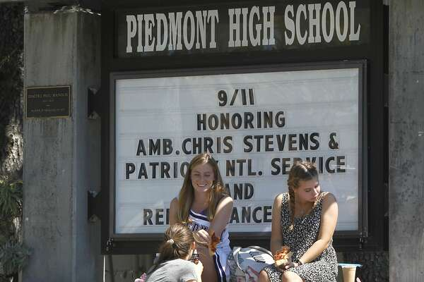 Students Ella Nielsen (front), Halle Potterton (left) and Hanna Pajt (right) eat lunch at the entrance to Piedmont High School in Piedmont, Calif. on Friday, Sept. 10, 2015. Piedmont High is one of the highest achieving schools in the Bay Area.