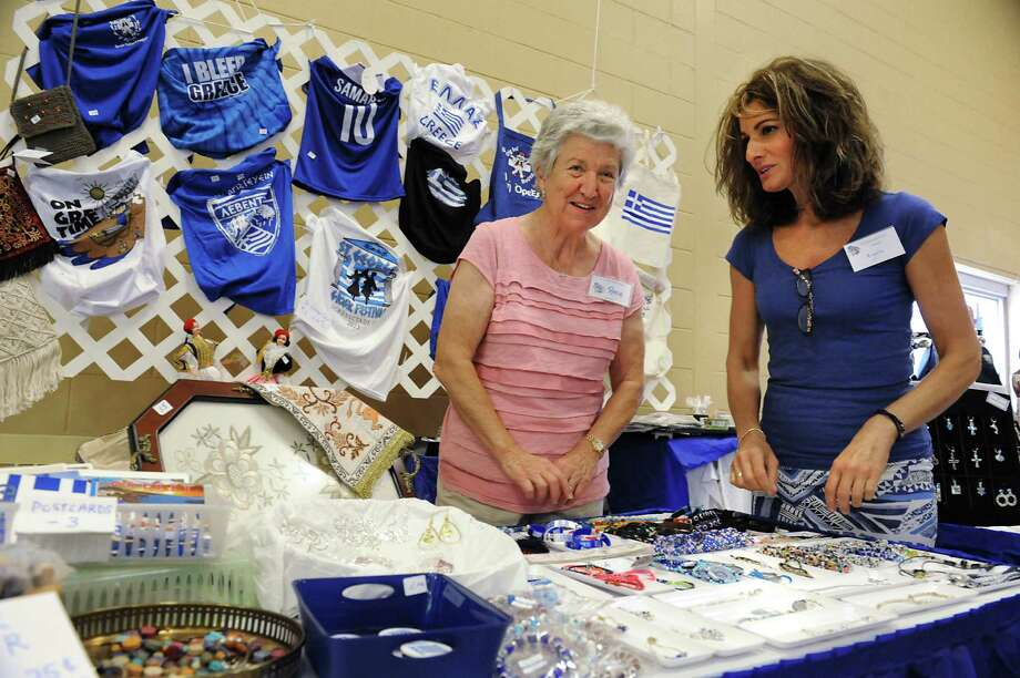 Rena Counavelis of Scotia, left, and Angela Menagias of Niskayuna sell crafts at the 40th Annual St. George Greek Festival at the Hellenic Center on Friday, Sept. 11, 2015 in Schenectady, N.Y. (Lori Van Buren / Times Union) Photo: Lori Van Buren / 00033222A