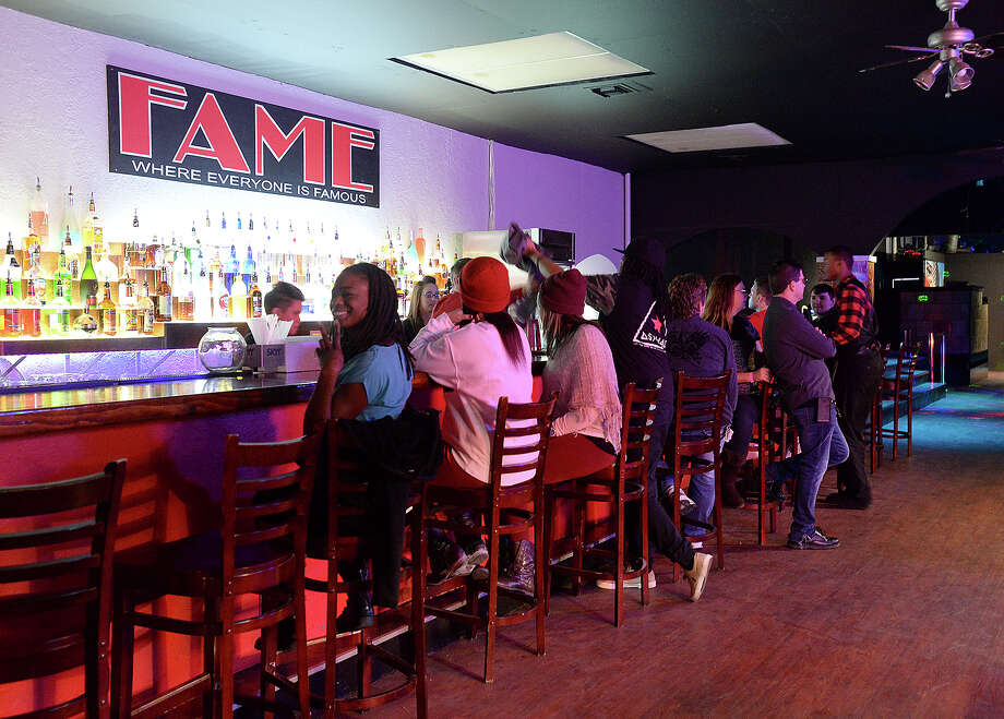The Friday night crowd gathers around the bar at Fame, Beaumont's newest gay club, which opened in the location formerly occupied by the Orleans Street Pub & Patio.  Photo taken Friday, January 9, 2015 Kim Brent/The Enterprise Photo: KIM BRENT / Beaumont Enterprise