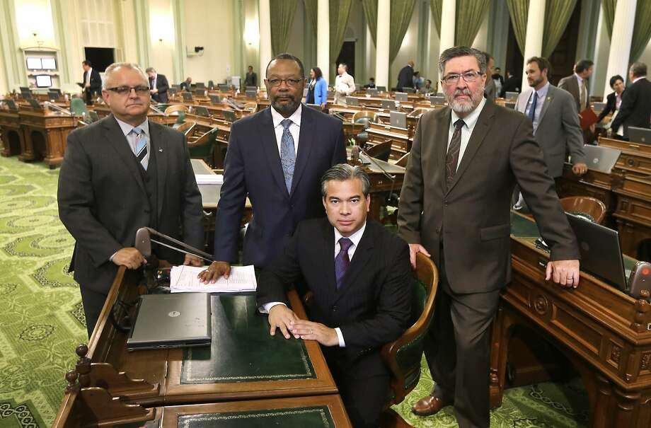 California Assemblymen Tom Lackey, R-Palmdale (left), Reginald Jones-Sawyer, D-Los Angeles, Rob Bonta, D-Oakland, and Ken Cooley, D-Rancho Cordova, pose for a photo at the Capitol in Sacramento, where lawmakers voted to create the first regulatory framework for the state's thriving but unruly medical marijuana industry on Sept. 11. Photo: Rich Pedroncelli, Associated Press