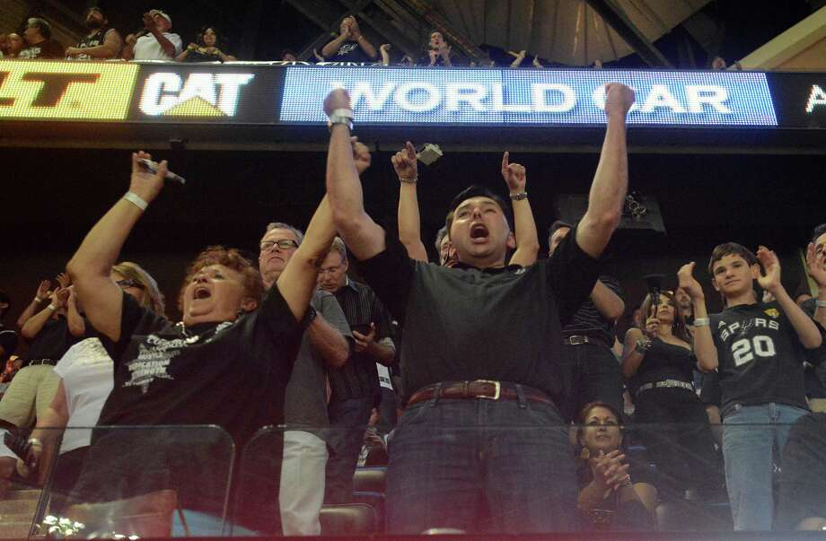 Spurs fans cheer on their team during game 5 of the NBA Finals in the AT&T Center on Sunday, June 15, 2014. Photo: Billy Calzada, Staff / San Antonio Express-News / San Antonio Express-News