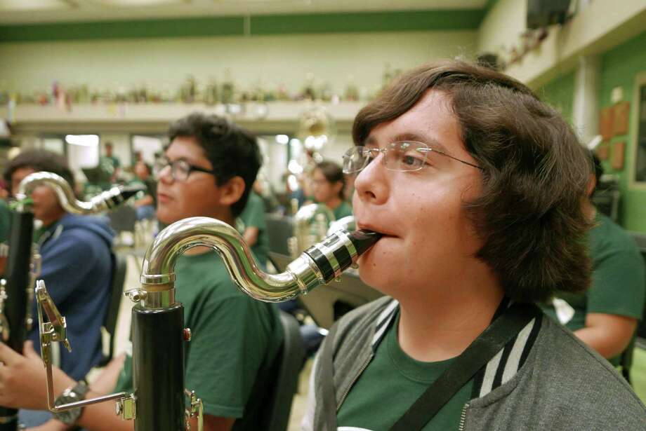Juan Ochoa plays his bass clarinet during a Southwest High School band rehearsal on Friday, Sept. 11, 2015. The school's wind ensemble has been invited to perform at Carnegie Hall next March. The band is raising money to pay for the trip to New York. Photo: Billy Calzada, Staff / San Antonio Express-News / San Antonio Express-News