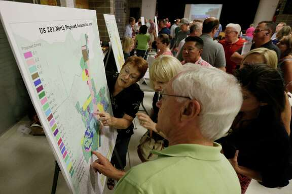 "City of San Antonio senior planner Margaret Pahl points at a map while attempting to field questions at an ""open house"" as the city considered annexing five large sections of unincorporated Bexar County last month."