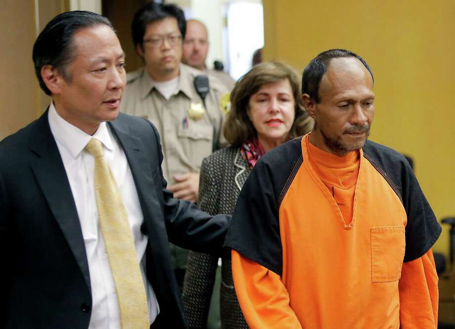 "Juan Francisco Lopez-Sanchez, shown here in July, is led into the courtroom by San Francisco Public Defender Jeff Adachi, for his arraignment at the Hall of Justice in San Francisco. The parents of Kathryn Steinle filed a wrongful death claim Sept. 1, alleging that the San Francisco Sheriff's Department is to blame for releasing an illegal immigrant from jail despite a federal ""detainer"" request to keep in custody for possible deportation proceedings. Photo: Michael Macor /Associated Press / Pool San Francisco Chronicle"
